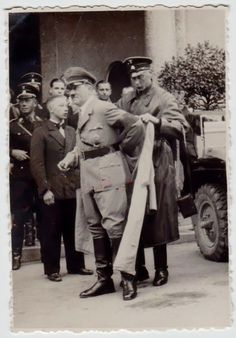 Hitler being assisted with his overcoat, 1936/37. None of the people surrounding him were part of his usual entourage.