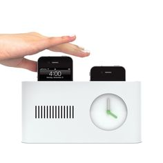 this alarm clock pops your phone out when it's time to get up