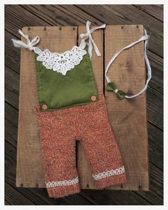 Adorable Romper for Fall! Orange and yellow toned sweater pants with crochet detailing and attached green light corduroy top. Top is accented