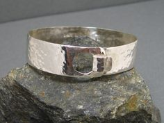 Sterling Silver Artisan Hammered Cuff Bangle Bracelet, Handcrafted Hand Forged Sterling Bracelet by Liz Blanchflower Stone and Sterlingl. $88.00, via Etsy.