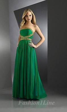Emerald green-- color of the year-- floor length gown with gold beaded detail. LOVE.