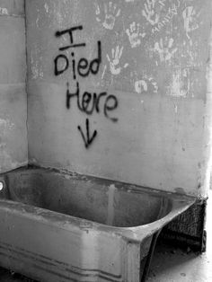 """I Died Here"" written on a wall inside the abandoned Jefferson Davis Hospital."
