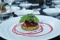 Seared cranberry goat cheese  cake topped with roasted beets and arugula with raspberry-beet dressing