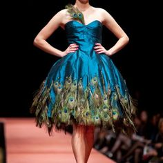 I have no idea where I would wear a peacock dress but it would be soo cool to have one. Perhaps halloween if it wasnt so cold here.