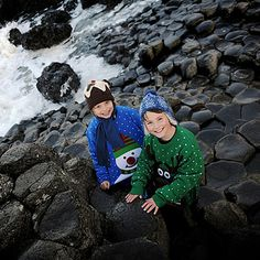 #whereswoolly today? Save the Children supporters Hector and Luc sport their finest Christmas jumpers and wooly hats for Christmas Jumper Day on the Giant's Causeway.