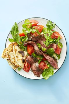 Satisfy your taco cravings with this salad recipe, then add tortilla slices to the plate when you're done mixing it all together! Click through to get the recipe for Grilled Steak Tortilla Salad! #healthydinners #healthydinnerrecipes #easydinnerrecipes #easyhealthydinners #mexicanfood