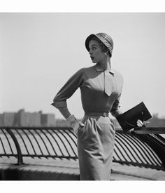 A young woman modelling a belted dress with pencil skirt, New York City, June 1953. (Photo by Slim Aarons:Hulton Archive:Getty Images)