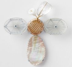 Christel Van der Laan – Butterfly Brooch. Painted sterling silver, 18ct gold, vintage camphor glass, mother of pearl button, mother of pearl shell, quartz, glass bead, freshwater pearl