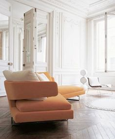 = orange sofa and white space