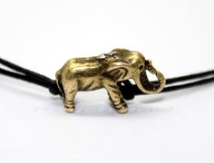 Super cute bracelet  3 d solid bronze elephants by itouchsoul, $0.99