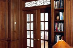 Elegant glass paned doors leading to a traditional library. From 1 of 7 projects by Four Square Design Studio. #interiors #interiordesign #decor