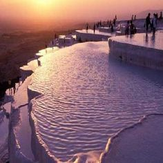 """18 Natural Wonders of the World Pamukkale """"cotton castle"""" hot springs southwestern Turkey. feet long and 525 feet high. Flowing water from the springs leaves limestone deposits down the mountain slope, forming what appears to be a frozen waterfall. Pamukkale, Places To Travel, Places To See, Places Around The World, Around The Worlds, Turkey Destinations, Picture Blog, Natural Wonders, Vacation Spots"""