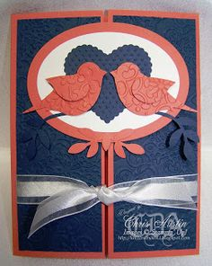 handcrafted card ... gate card ... could be a wedding or shower invitation  from * Luv 2 Cre8 With U! * ... red, white and blue ... punched birds beak to beak over a heart on mattted oval ... ribbon used to hold the card shut ... like this design ... would be great in other colors too ... Stampin' Up!