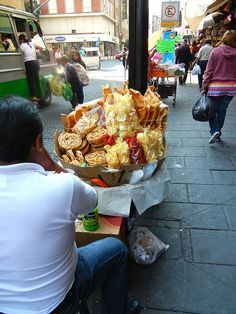 Churritos and papas w/ salsa.. We have a lot of botanas that we like to add lime juice, crema and salsa too.