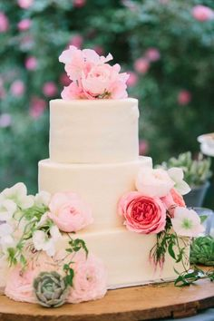 Gorgeous wedding cake decorated with pink Peonies, Garden Roses, and Succulents. #pink #wedding #inspiration