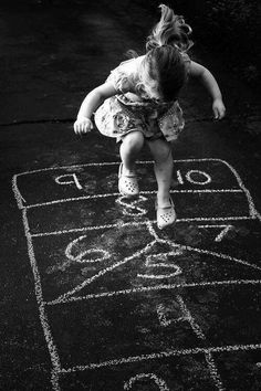 Black & White Photography - Girl & Hopscotch - This was one of my favorite pastimes in childhood.I miss that freedom, simple games, and time spent outdoors. Black White Photos, Black And White Photography, Little People, Little Girls, Hopscotch, Belle Photo, Kids Playing, Cute Kids, 5 Kids