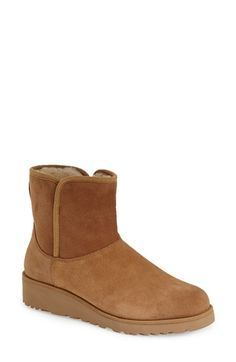 Free shipping and returns on UGG® Australia UGG™ Australia 'Kristin - Slim Classic™' Water Resistant Mini Boot (Women) at Nordstrom.com. Water-resistant suede upgrades a classic bootie, updated with a sleeker profile that streamlines this heritage style. Cozy shearlinglining and a cushy UGGpure™footbedhelp to keep you warm when winterweather strikes. UGGpure is a textile made entirely from wool, but shaped to feel and wear like genuine shearling.