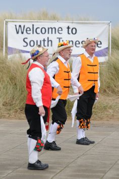 'Welcome to South Tyneside' Local Morris dancers entertain the crowds at South Shields, Littlehvane promenade.