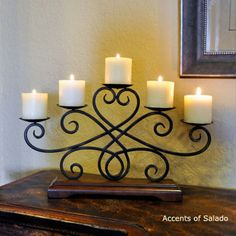 who doesn't love candles... + wrought iron and rich wood.