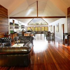 Stunning renovated church at Pokolbin for Usher Tinkler Wines Cellar and Salumi by Swannell Group using Round 2 Timbers great recycled Australian hardwood wall panels, flooring, bar tops. Photographs by Chris Elfes of Elfes Images