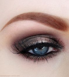 Red hair, bronze-silver eye make up