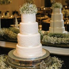 White Floral Decorated Cake with Baby's Breath Topper // Justin DeMutiis Photography //  Cake: Elise's Pieces // http://www.theknot.com/weddings/album/a-classic-timeless-wedding-in-tampa-fl-144319