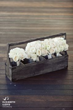 I love the idea of the old looking wood toolboxes. maybe for centerpieces.