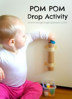Pom pom drop activity for toddlers. Great for fine motor skills and developing cause and effect. So easy to set up so start collecting your cardboard paper tubes. Activities For Infants, Baby Activities 1 Year, Learning Games For Toddlers, Simple Games For Kids, Games For Babies, Sensory Board For Babies, Toddler Sensory Activities, Color Activities For Toddlers, Toddler Games