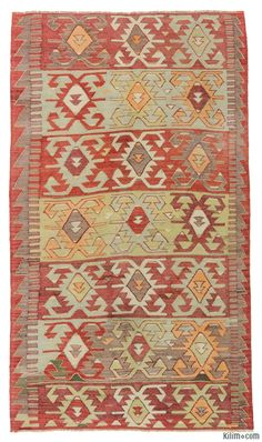 Vintage kilim rug handwoven in mid 20th century in the Konya region of Central Anatolia, Turkey. This tribal rug is in very good condition.