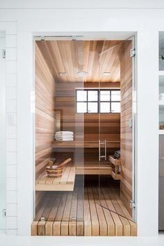 Relax and unwind in a master bathroom sauna finished in teak wood. Home Spa Room, Spa Rooms, Saunas, Bathroom Spa, Master Bathroom, Bathroom Mirrors, Wood Bathroom, Dream Home Design, House Design