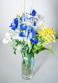 Jupiter - A cool and sophisticated toned bouquet featured with brilliant combination of flowers and textures, cobalt blue irises, snowy white daisy poms and sunshine yellow button chrysanthemums. This original arrangement is perfect for birthdays, mother's day or even just to say thank you. Vase Not Included. - See more at: http://www.timesflora.com/Shop-By-Price/View-All/Jupiter
