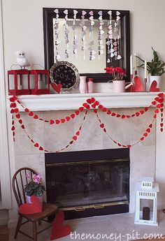 Valentine's Day Mantel - I love the felt heart garland. It was purchased at the Dollar Store. Love the red lanterns.
