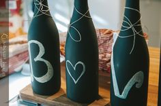 Custom chalkboard paint wine bottle decoration for wine & cheese snacks at engagement party