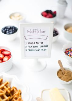 Build your own waffle bar with free printable. You can make the waffles ahead of time, freeze them and toast them as guests arrive on iheartnaptime.com
