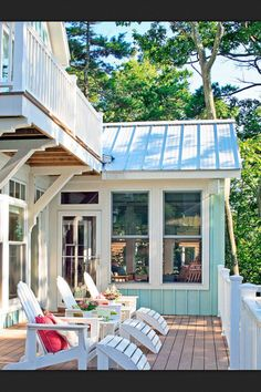 ENCLOSED BACK PORCH, DECK & BALCONY COMPLETE WITH ADIRONDACK LOUNGERS.