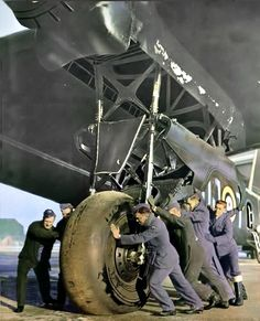 RAF aides try to remove a wheel landing gear of this huge heavy bomber Short Stirling. This was one of the biggest bombers of the war and the second in capacity.When it became obsolete over other as the Lancaster, I modified it to make transport glider. Ww2 Aircraft, Military Aircraft, Image Avion, Lancaster Bomber, Ww2 Planes, Landing Gear, Royal Air Force, Stirling, Military History