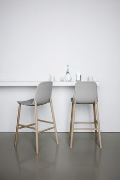 Sharky grey and wood stools white walls grey floors glass bottle