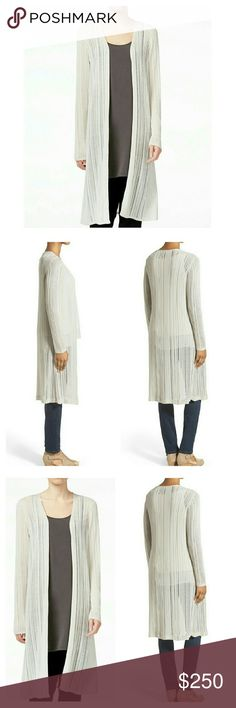 🆕 EILEEN FISHER Long Sleeve Tencel Cardigan AMAZING cardigan by Eileen Fisher, made for any season with Tencel yarn made in Italy from sustainably harvested trees and made in LA. Natural bone color, sleek linear design, long sleeve, open front, completes any look, day or night!!!  100% Tencel  Made in USA  Brand new with all tags Eileen Fisher Sweaters Cardigans