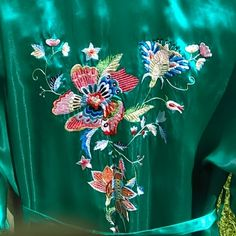 PEACOCK - 2 PC PJ/LOUNGE SET Aqua 2pc set - Robe features a large floral design on back, small floral designs on front with pockets and belt - Size XL, however, bottoms fit like a Large - NWOT - 55% Silk (the rest is in Mandarin)  PLEASE NOTE UPDATE: The elastic was removed from the pants and there are 2 small cut openings INSIDE the waistband.  Easily repairable.  See picture of same. Peacock Intimates & Sleepwear Robes