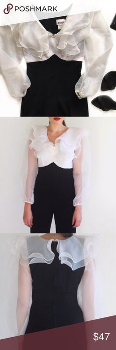"""Vintage Black White Ruffle Collar Jumpsuit White mesh collar & sleeves, dramatic ruffled collar, elastic cuffs, stirrup legging & back zipper. Tag is 7/8 but fits more like 3/4 (see measurements). Brand is Banner New York, vintage item. On left sleeve close to armpit there are 2 small holes(4th pic) not very noticeable since the collar covers it.Body 90% polyester, 10% lycra. Sleeves & Collar 100% polyester. Length:50"""" Bust:32"""" Waist:26"""" Hip:30"""" Shoulder to Shoulder:15"""" Sleeve Length:23""""…"""