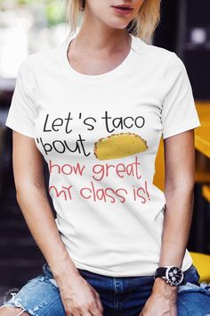 Show your love of tacos and teaching with this cute, fun teacher t-shirt. Let's Taco Bout How Great My Class Is is a fun food pun teacher tee. You'll love this fun teacher tee and it will be a great addition to your collection.
