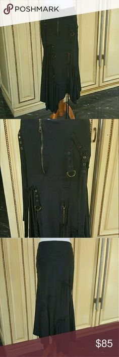 Vintage black suede skirt Black suede vintage skirt with ties, buckles and zippers . In good condition has no stretch to it. Skirts Maxi