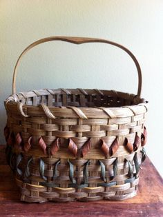 Handwoven basket signed by JunkyardGenes on Etsy, $19.00