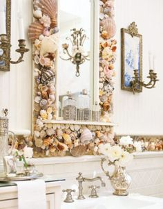 decorating with seashells - like the mirror idea. Not sure about shells as a backsplash border looks very BUSY!