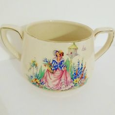 1930s / 1940s double handled hot chocolate cup or small soup bowl with vintage crinoline lady gathering flowers in a garden with a birdhouse https://www.etsy.com/uk/listing/497235000/beautiful-vintage-1930s-or-1940s-arthur