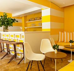 Bright yellow and orange cocktail bar at Lords South Beach in Miami