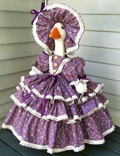 (goose not included). The cotton fabric used to make the entire dress, has a lavender background with tiny pink roses scattered through out the fabric. The hat was made from the same fabric and lace as the dress, and has a dark purple bow attached to the front edge of the brim.   eBay!