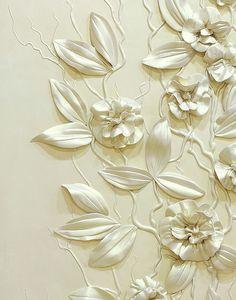 Beautiful sculpted flowers adorn a wall from Zoya Olefir #home #decor #design