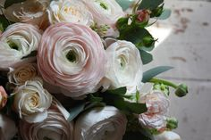 So pretty, a pink posy of ranunculus & roses.