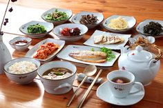 """Baekban(백반): a simple meal with rice, soup and Banchan. This table has more dishes than Bulgogi Jeongsik above. But this meal doesn't have a """"featured"""" dish. It's a basic meal with rice and Banchan only. So it's just Baekban."""